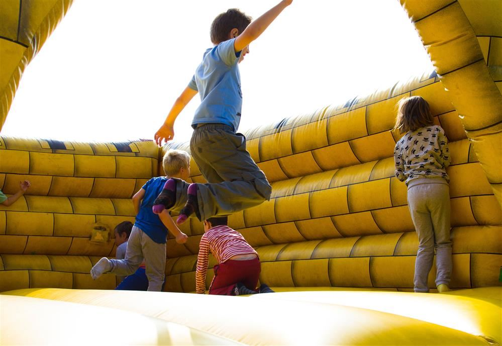 kid jumping in bounce house