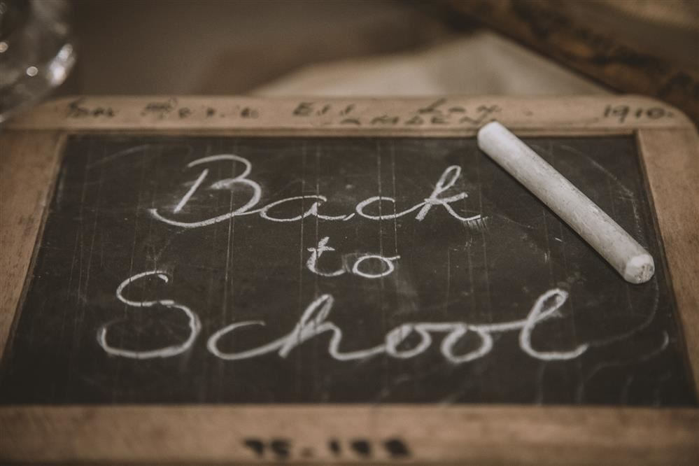 back to school in chalk on chalkboard
