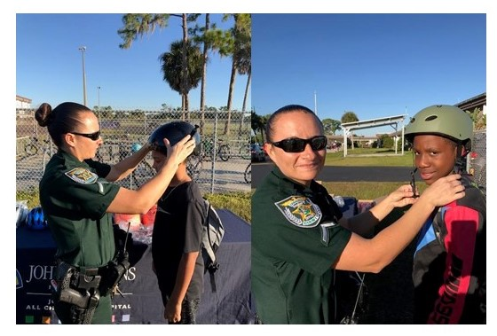 Deputy helps bike rider put on helmet