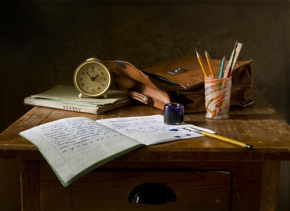 Desk with books and pens