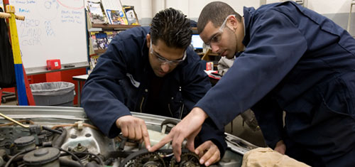Automotive students working on a vehicle.
