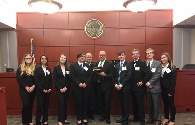 Mock Trial Champions posing for a photo with award.