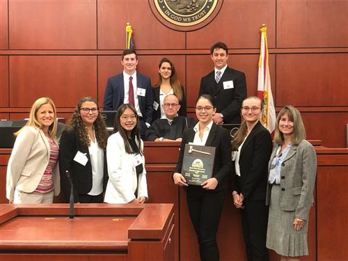 mock trial winners posing with award